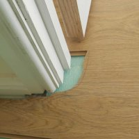 Cutting to fit under door jambs
